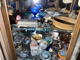 Two shelves of paperweights, assorted other items