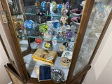 Three shelves of paperweights, assorted other items