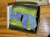 Pair of Green and blue boots by Ariat