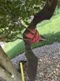 Large metal bat yard art piece