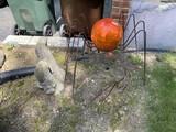 Rebar metal spider, Praying mantis, cement Easter Island heads