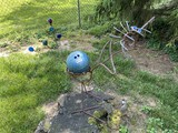 Yard art bird with bowling ball