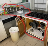 Assorted cookware in cupboard, canisters on counter