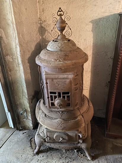 Large old antique pot belly stove