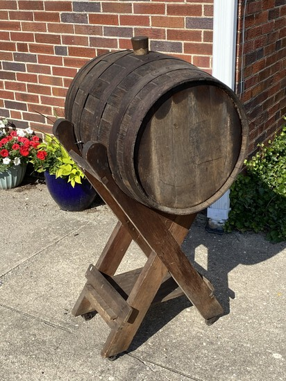 Vintage wine or whiskey barrel on stand