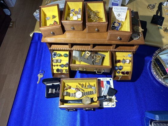 Jewelry box filled with men's jewelry, watches