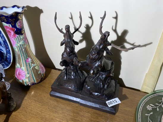 Pair of wooden Black Forest carved elk or deer bookends