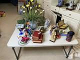 Assorted vintage items on table - books, ceramics, brass, clowns etc