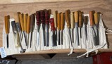 Large lot of assorted chisels and more