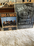 Jack Daniels sign and Guns and Roses poster
