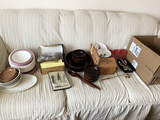 Glassware on Couch - plates, wood bowls, OSU glassware, clear glassware, Disney plastic plate and Bo