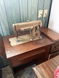 Vintage Singer Sewing Machine with sewing cabinet
