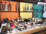 Contents of Work Bench including Vise and Trophies
