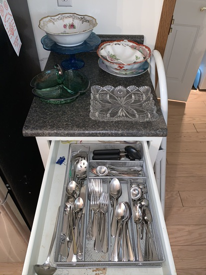 Assorted glassware, step stool, and flatware