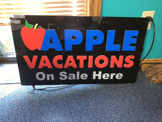 Neon Tech Apple Vacations Advertising Sign