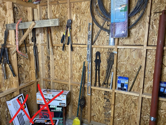 Assorted tools hanging on wall