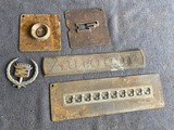 Group of old automotive insignia chroming masks or molds