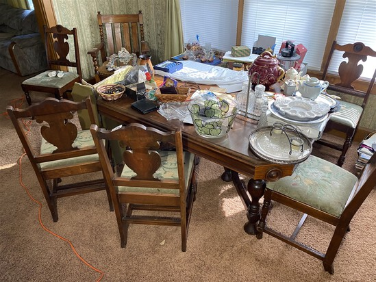 Antique table and six dining chairs