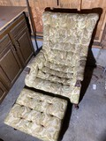 Vintage upholstered chair and footstool