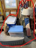 Old flags, totes of xmas, folding chairs and more lot
