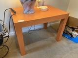 Vintage orange colored lamp table