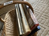 Assorted books in basket