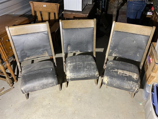 Group of three antique folding theater seats