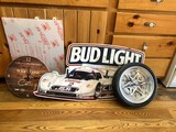 Tire Rim Clock, Anheuser-Busch Metal Sign, Cottage Clock, & Piece of Plexiglass