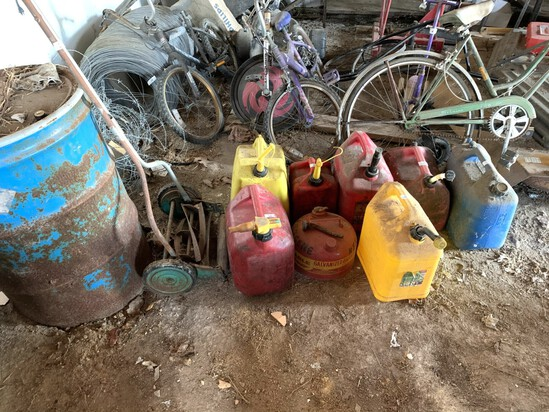 8 Gas Cans & Antique Lawn Mower