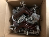 2 Boxes Containing 100 Wooden Hangers Each