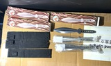 Group lot of throwing knives in boxes