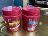 Two containers of jewelry cleaner
