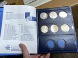 8 Peace Silver DOllar Coins in Album