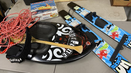 Wake board, water skis, inflatable pull behind lot