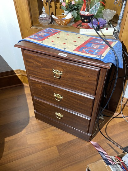 Small cabinet with three drawers