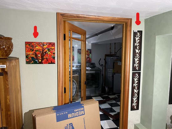 Tile Art and vertical are to the left and right of door frame