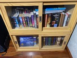Assorted books in cabinet