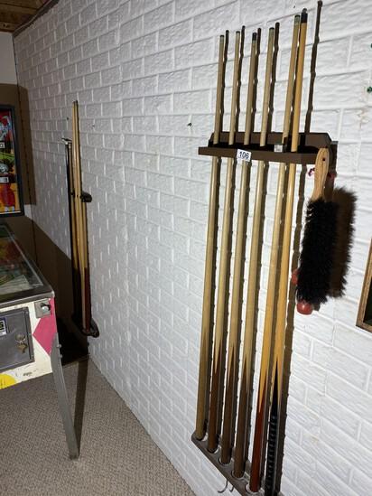 2 racks full of Vintage Pool Cue Sticks