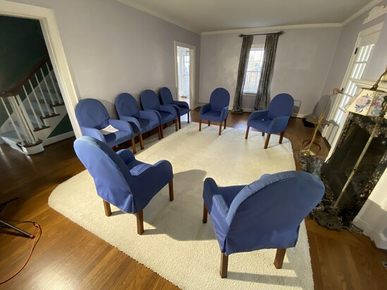 Group of 8 chairs with blue covers