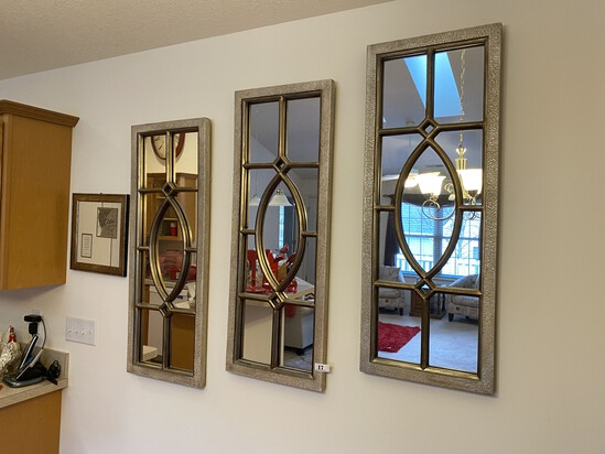 Three decorative mirrors and a frame