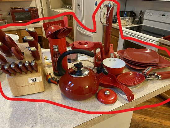 Kitchen knives in block plus red kitchen items