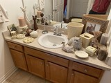 Large lot of decorative items in bathroom