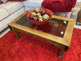 Glass topped coffee table with bowl, decorative veggies