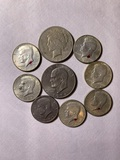 1 1923 Peace Dollar, 1 1974 Ike Dollar, & 7 Kennedy Half Dollars coins