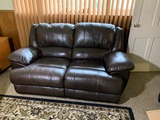 Nice Leather Look Loveseat with Reclining Feature