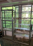 2 Chrome and Glass Shelving Units.  See Photos..