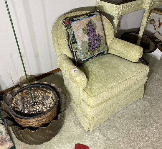 Upholstered chair and large metal planter
