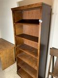 Tall wooden bookshelf