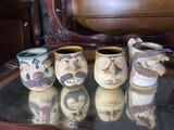 Group lot of four art pottery mugs
