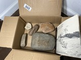 Box of Native American artifacts and book